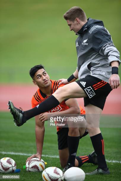 Rieko Ioane and Jordie Barrett warm up during a New Zealand All Blacks training session at Trusts Stadium on June 22 2017 in Auckland New Zealand
