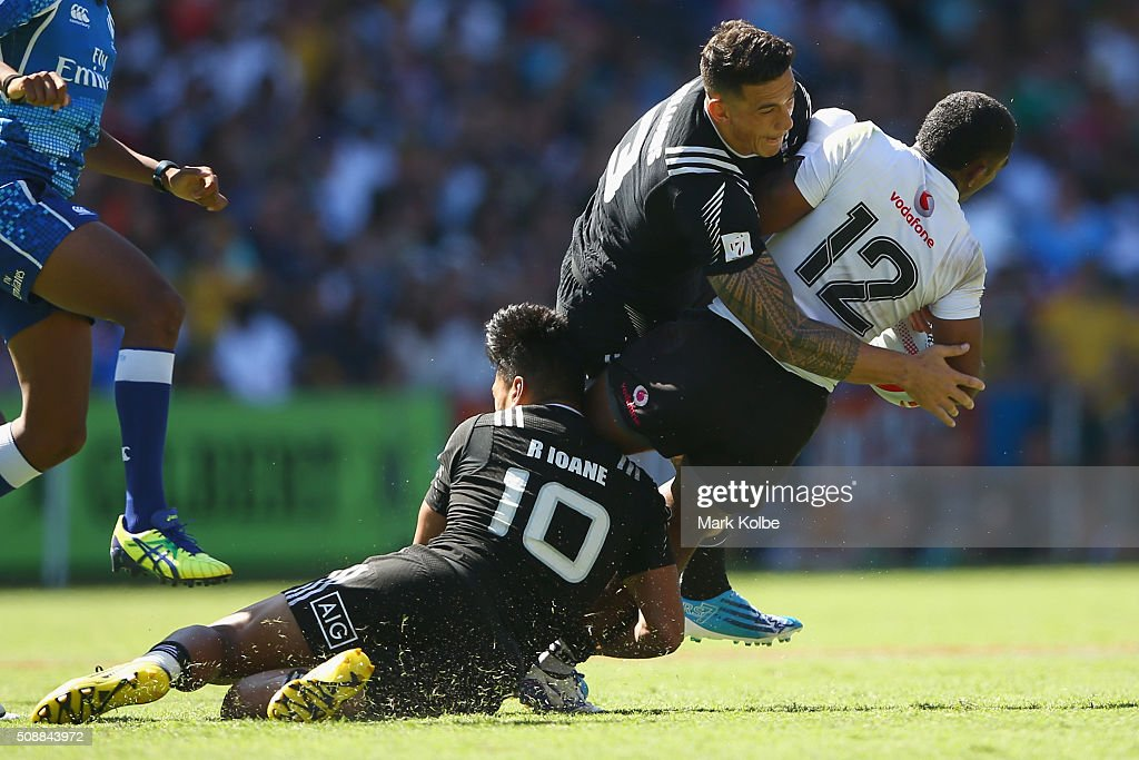Rieko Ioane and Sonny Bill Williams of New Zealand tackle Vatemo Ravouvou of Fiji during the 2016 Sydney Sevens cup semi final match between New Zealand and Fiji at Allianz Stadium on February 7, 2016 in Sydney, Australia.