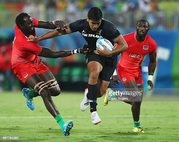 Rieko Ioane of New Zealand holds off Humphrey Kayange of Kenya during the Men's Rugby Sevens Pool C match between New Zealand and Kenya on Day 4 of...