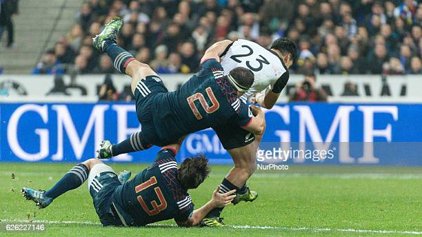 Rieko Ioane of New Zealand is tackled by French players Guilhem Guirado and Remi Lamerat during the international friendly test match between France...