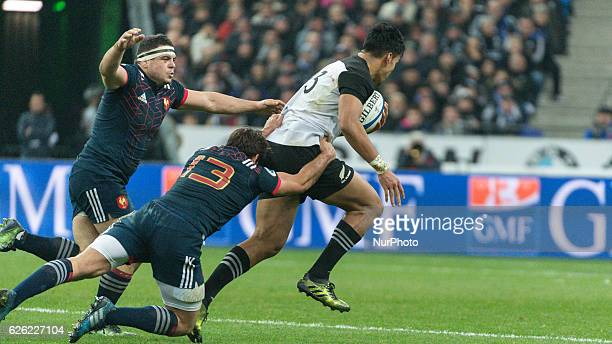 Rieko Ioane of New Zealand is tackled by Remi Lamerat of France during the international friendly test match between France and New Zealand at Stade...