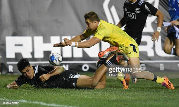 Rieko Ioane of New Zealand loses the ball as he is tackled just shy of the try zone by Greg Jeloudev of Australia during the USA Sevens Rugby...