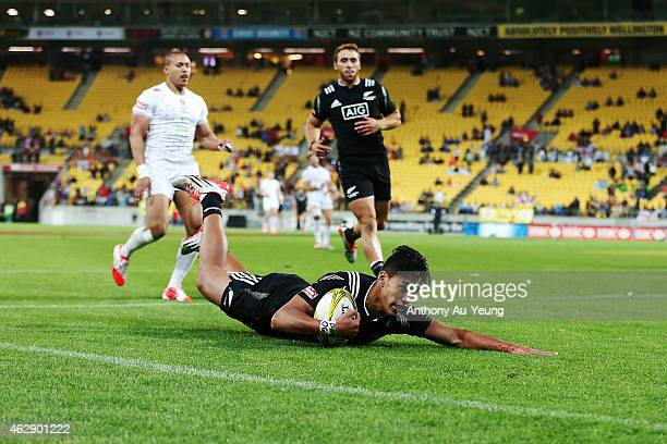 Rieko Ioane of New Zealand scores a try during the cup final match between New Zealand and England in the 2015 Wellington Sevens at Westpac Stadium...