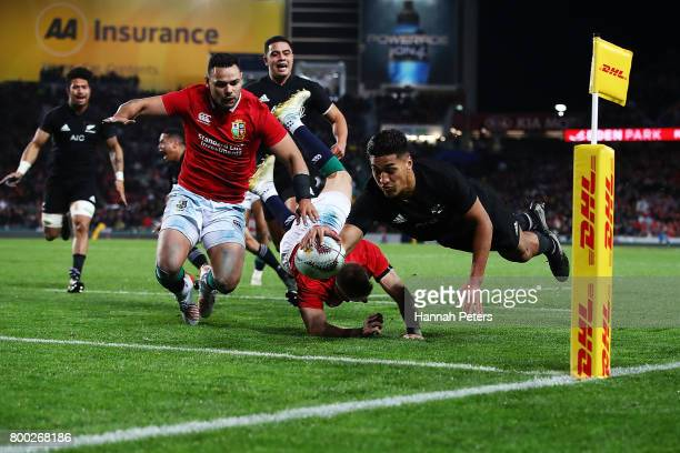 Rieko Ioane of the All Blacks dives in to score a try during the Test match between the New Zealand All Blacks and the British Irish Lions at Eden...