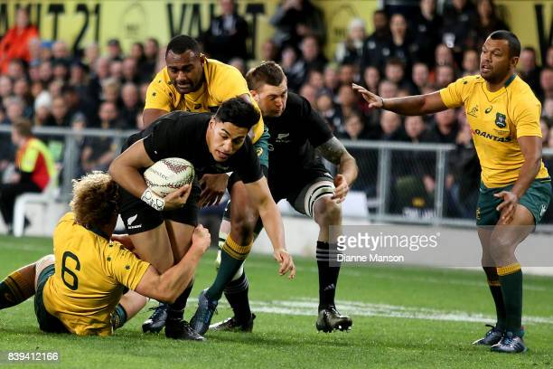 Rieko Ioane of the All Blacks is tackled by Ned Hanigan of the Wallabies during The Rugby Championship Bledisloe Cup match between the New Zealand...