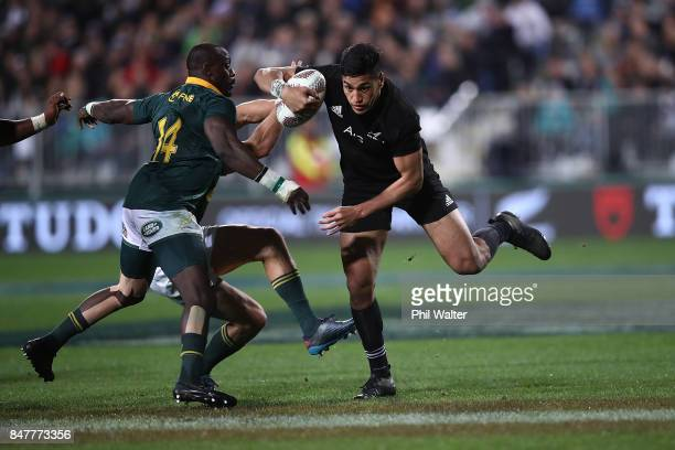 Rieko Ioane of the All Blacks makes a break during the Rugby Championship match between the New Zealand All Blacks and the South African Springboks...