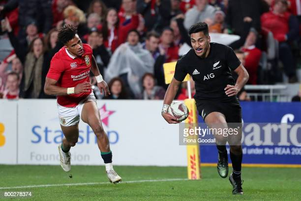 Rieko Ioane of the All Blacks scores a try with Anthony Watson of the Lions chasing during the Test match between the New Zealand All Blacks and the...