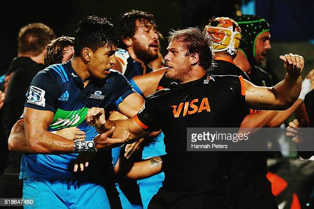 Rieko Ioane of the Blues fights with Facundo Bosch of the Jaguares during the round 6 super rugby match between the Blues and the Jaguares at QBE...