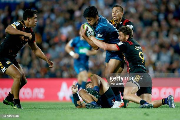 Rieko Ioane of the Blues is tackled by Tawera KerrBarlow of the Chiefs during the round two Super Rugby match between the Chiefs and the Blues at...