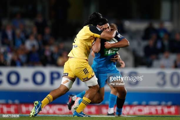 Rieko Ioane of the Blues is tackled during the round eight Super Rugby match between the Blues and the Highlanders at Eden Park on April 15 2017 in...