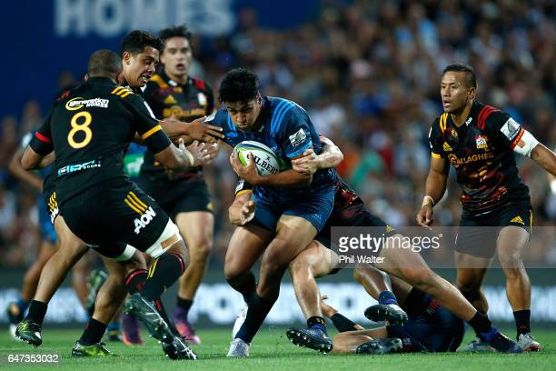 Rieko Ioane of the Blues is tackled during the round two Super Rugby match between the Chiefs and the Blues at Rugby Park on March 3 2017 in Hamilton...