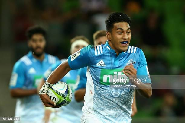 Rieko Ioane of the Blues makes a break to run in a try during the round one Super Rugby match between the Melbourne Rebels and the Auckland Blues at...