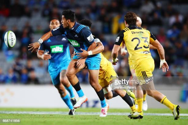Rieko Ioane of the Blues offloads the ball during the round eight Super Rugby match between the Blues and the Highlanders at Eden Park on April 15...