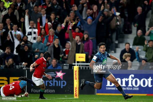 Rieko Ioane of the Blues runs over to score a try during the match between the Auckland Blues and the British Irish Lions at Eden Park on June 7 2017...