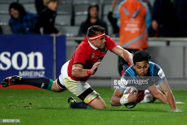 Rieko Ioane of the Blues scores a try during the match between the Auckland Blues and the British Irish Lions at Eden Park on June 7 2017 in Auckland...