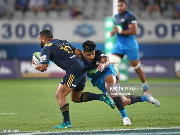 Rieko Ioane of the Blues tackles Lima Sopoaga of the Highlanders during the round three Super Rugby match between the Blues and the Highlanders at...