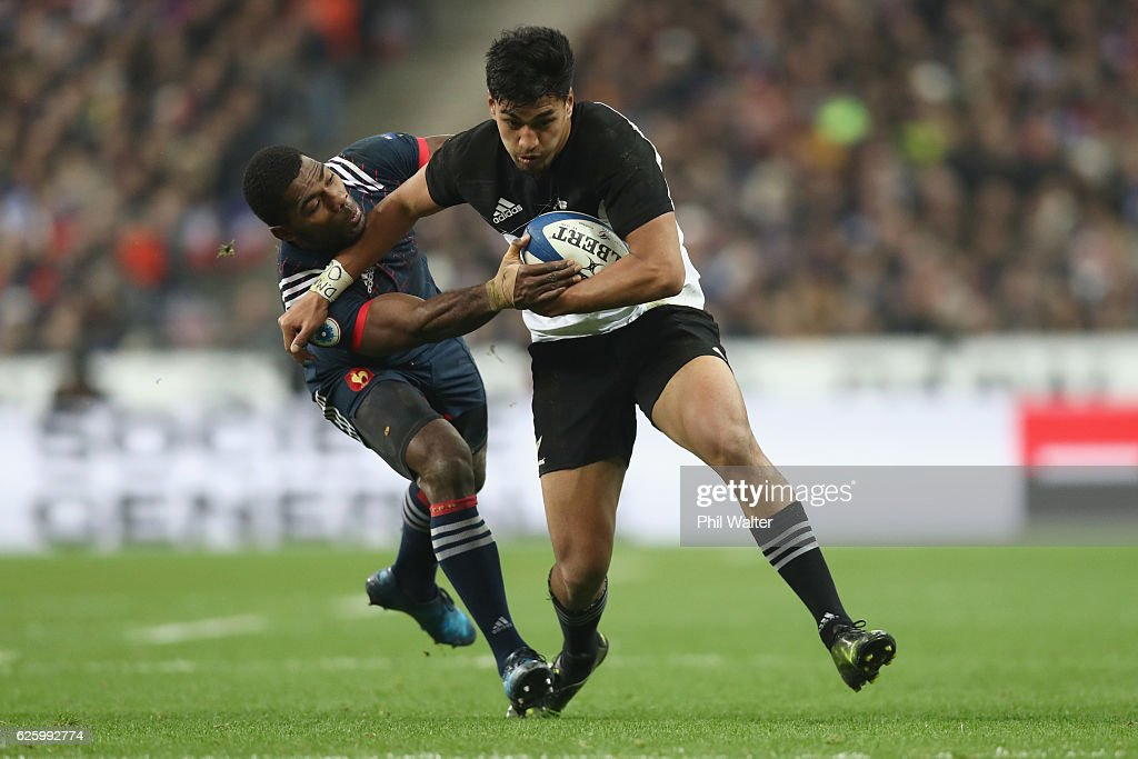 Rieko Ioane of the New Zealand All Blacks is tackled by Noa Nakaitaci of France during the international rugby match between France and New Zealand at Stade de France on November 26, 2016 in Paris, France.