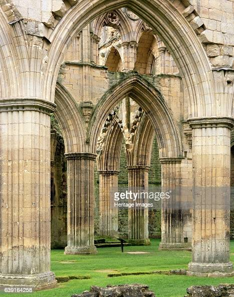 Rievaulx Abbey North Yorkshire c19902010 The arches and buttresses of the north side of the abbey church A former Cistercian abbey in the North York...