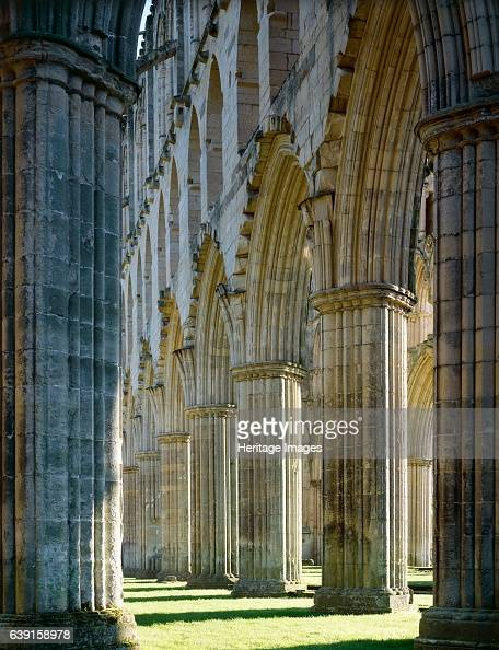 Rievaulx Abbey North Yorkshire c19902010 The arches on the south side of the presbytery from the east end of the abbey church autumn sunshine A...