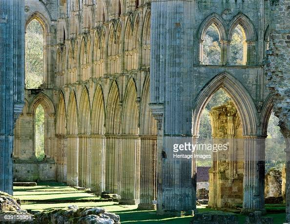 Rievaulx Abbey North Yorkshire c19902010 The arches on the south side of the presbytery from the middle of the abbey church autumn colour A former...