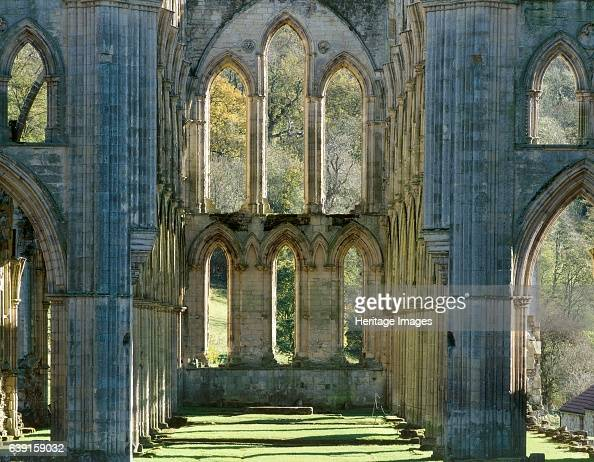 Rievaulx Abbey North Yorkshire c19902010 The window at the east end of the abbey church showing autumn colour on the trees beyond A former Cistercian...