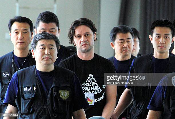 Rifat Hadziahmetovic a member of gang Pink Panther is seen as he is extradited to Japan at Narita International Airport on August 14 2010 in Narita...