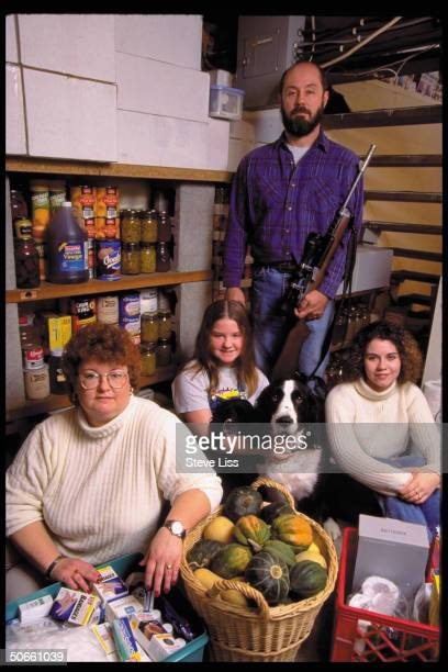Riflearmed Bruce Eckhart family w their Y2K stockpile of household medical supplies preparing for possible millennium apocalypse caused by Year 2000...
