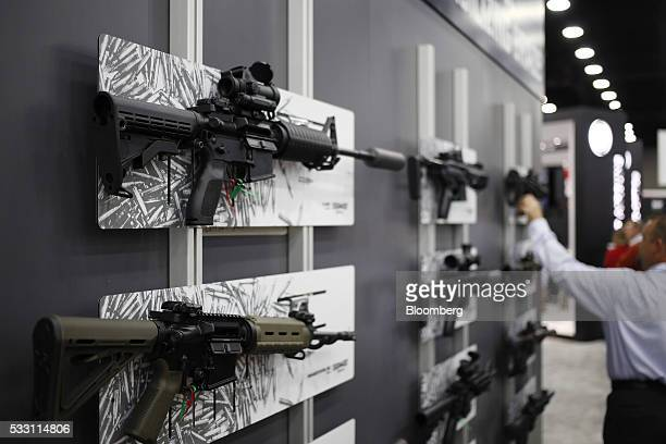 AR15 rifles are displayed at the SIG Sauer GmbH booth on the exhibit floor during the National Rifle Association annual meeting in Louisville...