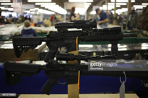 AR15 rifles are displayed for sale at a vendor's booth during the Fall 2015 Knob Creek Machine Gun Shoot in West Point Kentucky US on Friday Oct 9...