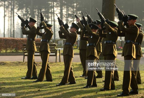 Rifles are fired at the cremation of Rifleman Jamie Gunn after the funeral service at St Mary's Church in Monmouth Rifleman Jamie Gunn was with...