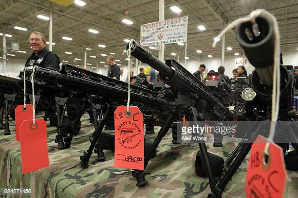 AR15 rifles are on display during the Nation's Gun Show November 18 2016 at Dulles Expo Center in Chantilly Virginia The show is one of the largest...
