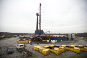 A rig drills for natural gas at a hydraulic fracturing site owned by EQT Corp located atop the Marcellus shale rock formation in Washington Township...