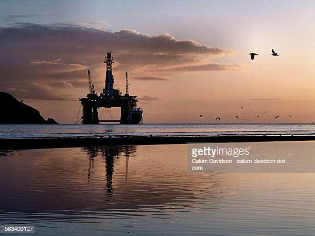 Rig, morning light and gulls