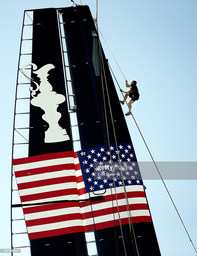 Rig team manager Andrew Henderson climbs up the side of the mast on the new Oracle Team USA AC72 on April 23, 2013 in San Francisco, California. This racing yacht will be used in this year's America Cup Finals, which will be held in San Francisco Bay between September 7-22.