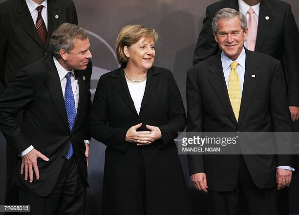 NATO Secretary General Jaap de Hoop Scheffer shares a laugh with German Chancellor Angela Merkel and US President George W Bush as they arrive for a...