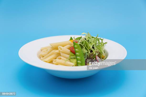 Rigatoni with varieties of vegetables in plate
