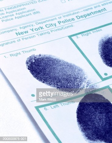 Right and left thumbprints on police blotter : ストックフォト