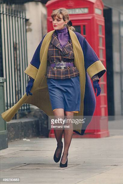 Right Blair's doublefaced wool coat with kimono colar over tartan jacket and slim skirt