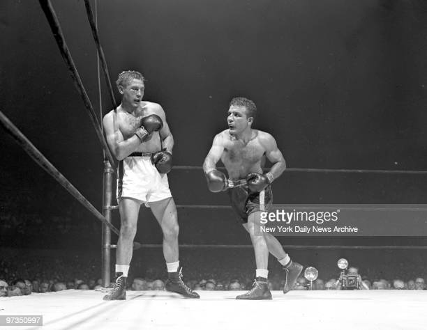 Right eye closed Tiberio Mitri is pounded into the ropes in a late round by Jake LaMotta