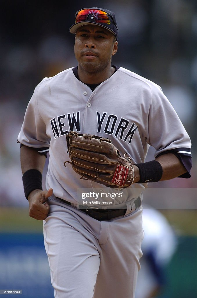 Right fielder Bernie Williams of the New York Yankees looks to the dugout as he runs off the field during the game against the Texas Rangers at...