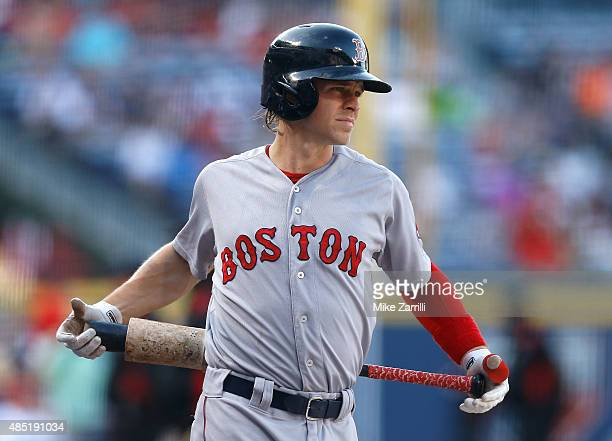 Right fielder Brock Holt of the Boston Red Sox warms up in the ondeck circle during the game against the Atlanta Braves at Turner Field on June 17...