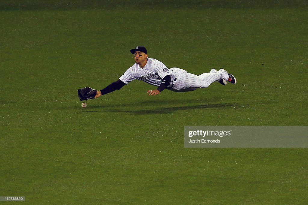 Right fielder Carlos Gonzalez #5 of the Colorado Rockies comes up short on a single off the bat of Adrian Gonzalez (not pictured) of the Los Angeles Dodgers during the sixth inning at Coors Field on May 8, 2015 in Denver, Colorado.