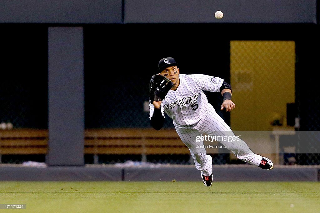 Right fielder <a gi-track='captionPersonalityLinkClicked' href=/galleries/search?phrase=Carlos+Gonzalez+-+Amerikansk+basebollspelare&family=editorial&specificpeople=7204259 ng-click='$event.stopPropagation()'>Carlos Gonzalez</a> #5 of the Colorado Rockies makes a catch for the second out of the fourth inning against the San Francisco Giants at Coors Field on April 25, 2015 in Denver, Colorado. The Giants defeated the Rockies 5-4 in 11 innings.