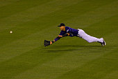 Right fielder Carlos Gonzalez of the Colorado Rockies makes a diving catch for the first out of the ninth inning against the Philadelphia Phillies at...