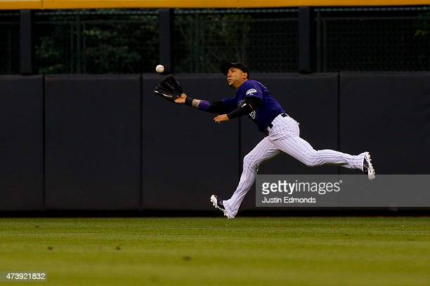 Right fielder Carlos Gonzalez of the Colorado Rockies makes a running catch for the first out of the first inning against the Philadelphia Phillies...