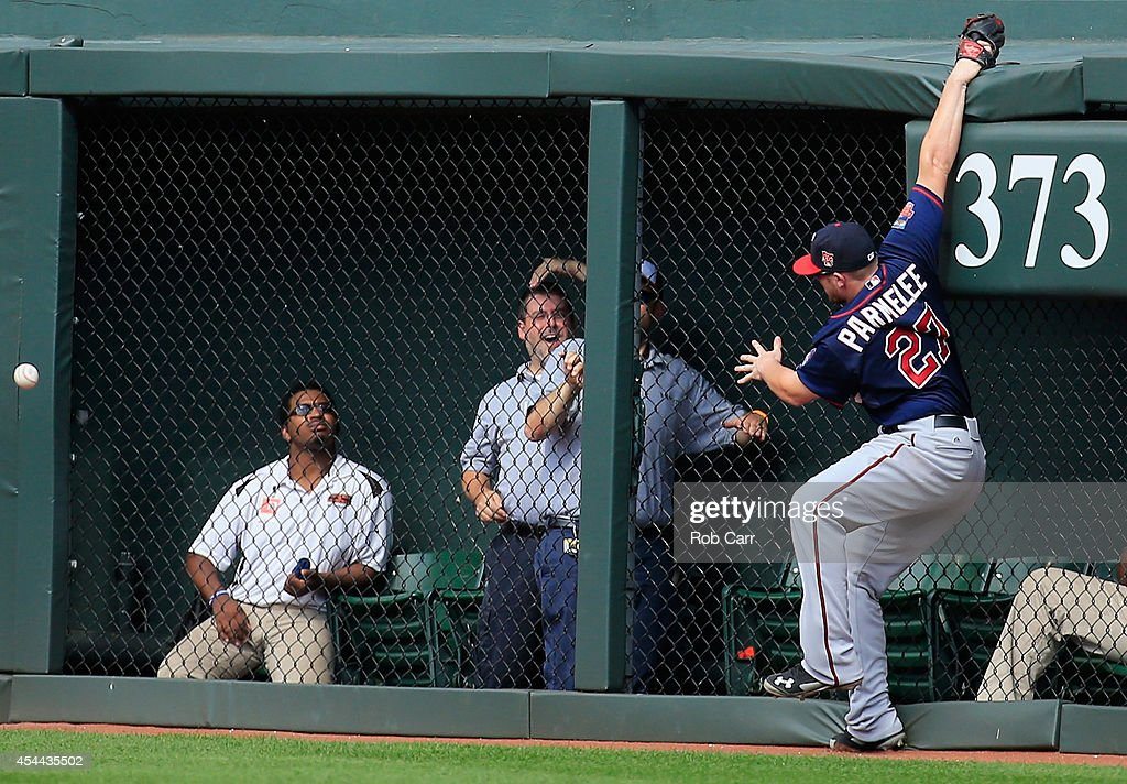 Right fielder <a gi-track='captionPersonalityLinkClicked' href=/galleries/search?phrase=Chris+Parmelee&family=editorial&specificpeople=713101 ng-click='$event.stopPropagation()'>Chris Parmelee</a> #27 of the Minnesota Twins goes up for a triple hit by Ryan Flaherty #3 of the Baltimore Orioles (not pictured) during the sixth inning at Oriole Park at Camden Yards on August 31, 2014 in Baltimore, Maryland.