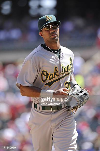 Right fielder Chris Young of the Oakland Athletics runs off the field after the third out of the inning in the game against the Texas Rangers at...