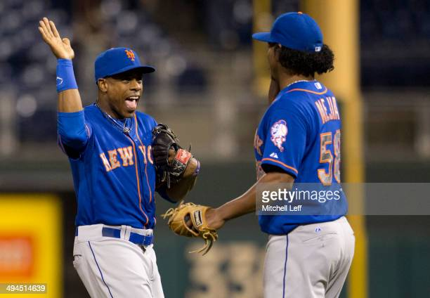 Right fielder Curtis Granderson and pitcher Jenrry Mejia of the New York Mets react after defeating the Philadelphia Phillies on May 29 2014 at...