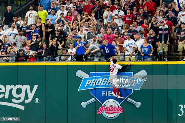 Right fielder Daniel Robertson of the Cleveland Indians can't get to a home run hit by Cody Bellinger of the Los Angeles Dodgers during the eighth...