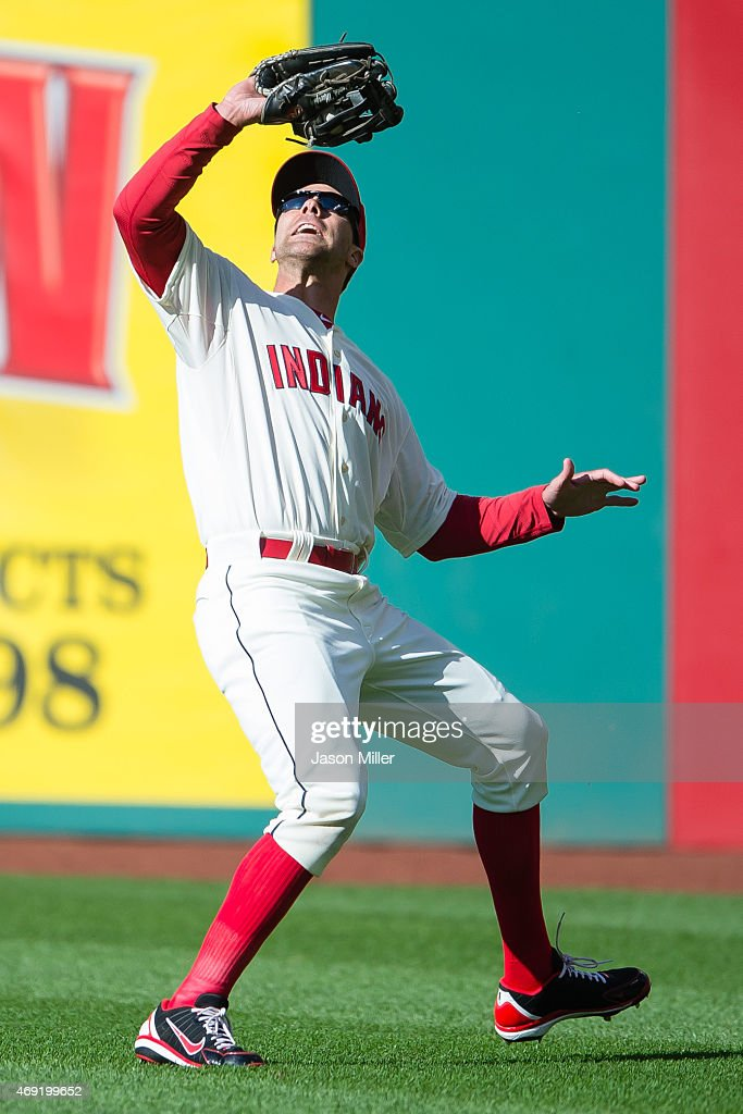 Right fielder <a gi-track='captionPersonalityLinkClicked' href=/galleries/search?phrase=David+Murphy+-+Baseball+Player&family=editorial&specificpeople=4604222 ng-click='$event.stopPropagation()'>David Murphy</a> #7 of the Cleveland Indians catches a fly ball hit by <a gi-track='captionPersonalityLinkClicked' href=/galleries/search?phrase=J.D.+Martinez&family=editorial&specificpeople=7520024 ng-click='$event.stopPropagation()'>J.D. Martinez</a> #28 of the Detroit Tigers during the third inning during the home opener at Progressive Field on April 10, 2015 in Cleveland, Ohio.